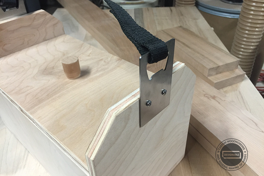 Add a hook ( i used a bottle opener) and strap as a handle