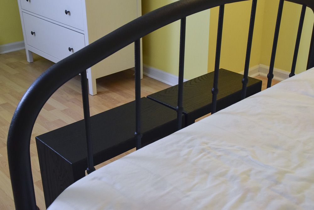 view of black oak sitting benches thru bed footboard
