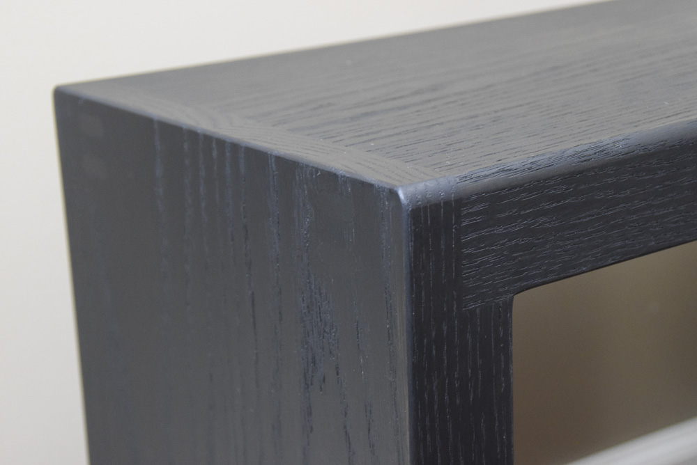 corner detail of black oak sitting benches