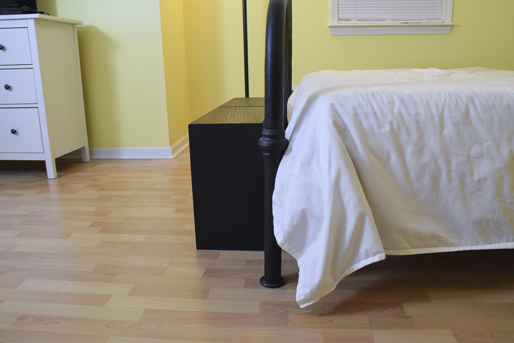 side view of black oak sitting benches at end of bed