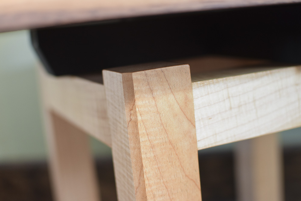 leg chamfer detail of the walnut and maple open end table