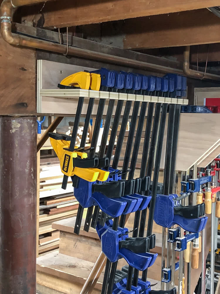 quick clamps installed in the oak plywood quick clamp rack