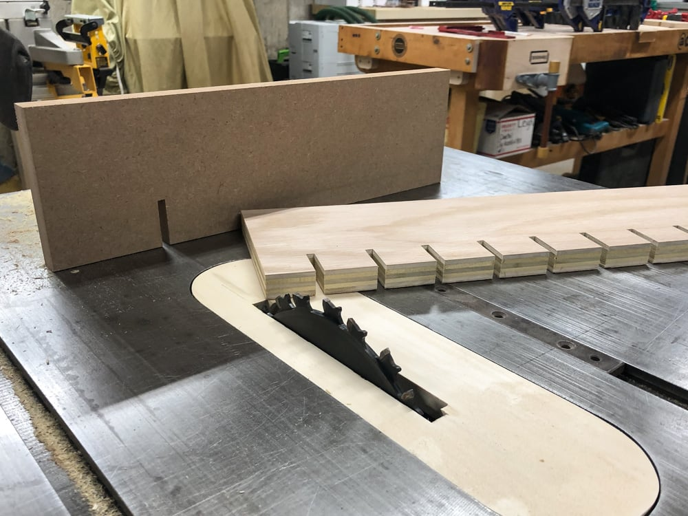cutting the plywood for the quick clamp rack on the tablesaw